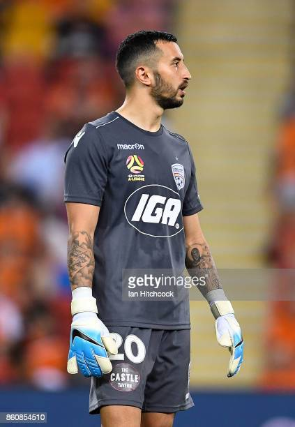 Paul Izzo of Adelaide United looks on during the round two ALeague match between the Brisbane Roar and Adelaide United at Suncorp Stadium on October...
