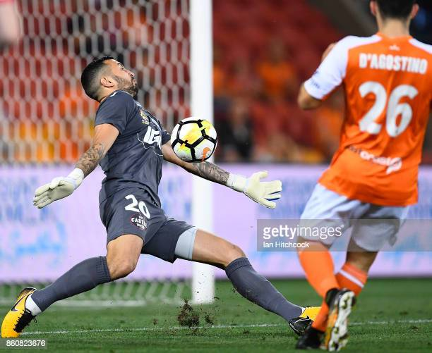 Paul Izzo of Adelaide United makes a save during the round two ALeague match between the Brisbane Roar and Adelaide United at Suncorp Stadium on...