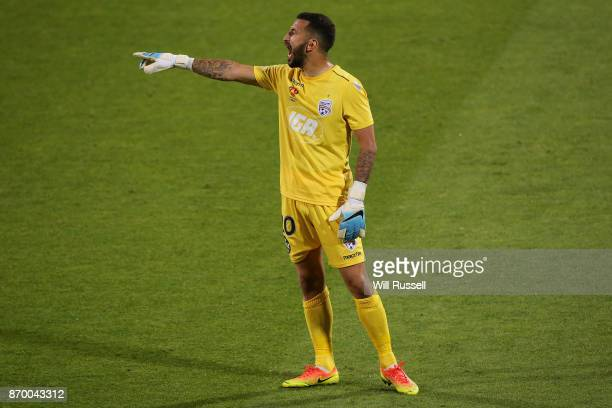 Paul Izzo of the Reds shouts instructions to the team during the round five ALeague match between the Perth Glory and Adelaide United at nib Stadium...