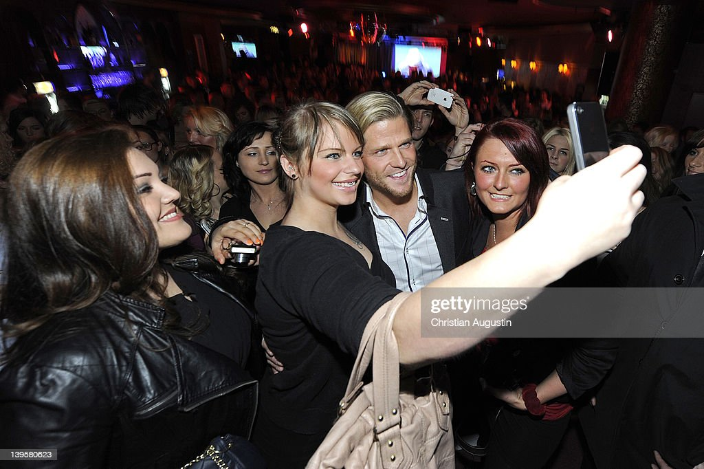Paul Janke 'The Bachelor' poses with fans during the Bachelor Party at Cafe Keese on February 22 2012 in Hamburg Germany