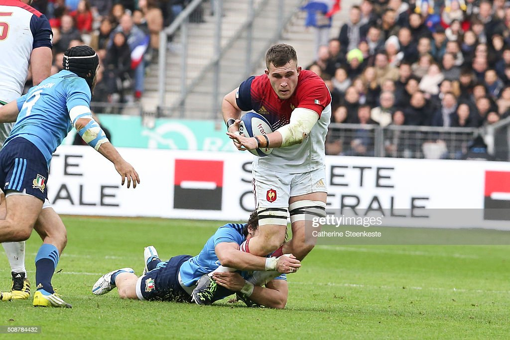 Paul Jedrasiak #4 of France is tackled by Michele Campagnaro #13 of Italy during the RBS Six Nations game between France and Italy at Stade de France on February 6, 2016 in Saint Denis near Paris, France.