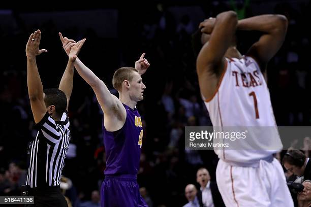 Paul Jesperson of the Northern Iowa Panthers celebrates after hitting a half court three pointer at the buzzer to defeat the Texas Longhorns with a...