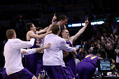Paul Jesperson of the Northern Iowa Panthers celebrates with his teammates after hitting a half court three pointer at the buzzer to defeat the Texas...