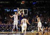 Paul Jesperson of the Northern Iowa Panthers hits a half court three pointer at the buzzer to defeat the Texas Longhorns with a score of 75 to 72...