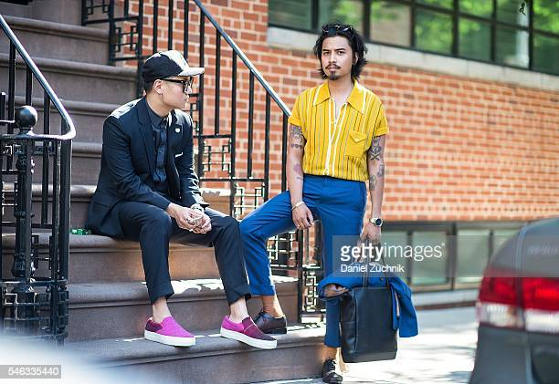 Paul Jin is seen outside the Krammer Stoudt show wearing a Reiss blue suit HM button down shirt Greats shoes Gentle Monster sunglasses and 47 brand...