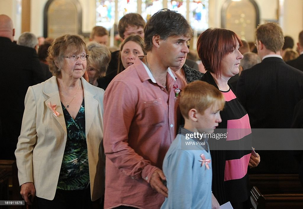 Paul Jones and Coral Jones (R) leave with their son Harvey and family members after the funeral of their daughter, murdered schoolgirl April Jones, inside St Peter's Church on September 26, 2013 in Machynlleth, Wales. Local man Mark Bridger, aged 47, was found guilty of abducting and murdering five-year-old April who went missing in Machynleth on October 1, 2012.