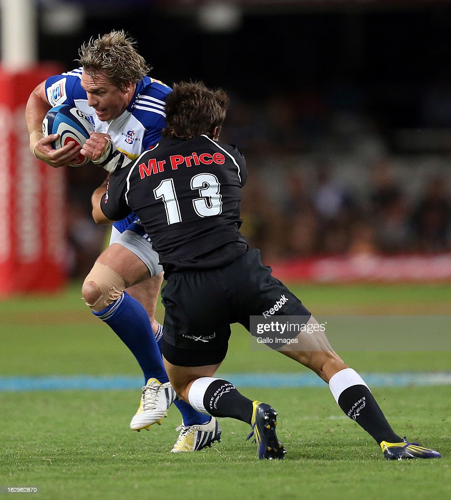 AFRICA - MARCH 02, Paul Jordaan looks to tackle Jean de Villiers (captain) during the Super Rugby match between The Sharks and DHL Stormers at Kings Park on March 02, 2013 in Durban, South Africa.