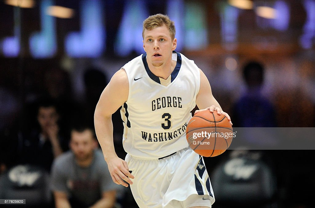 Paul Jorgensen of the George Washington Colonials handles the ball against the George Mason Patriots at the Charles E Smith Athletic Center on March...