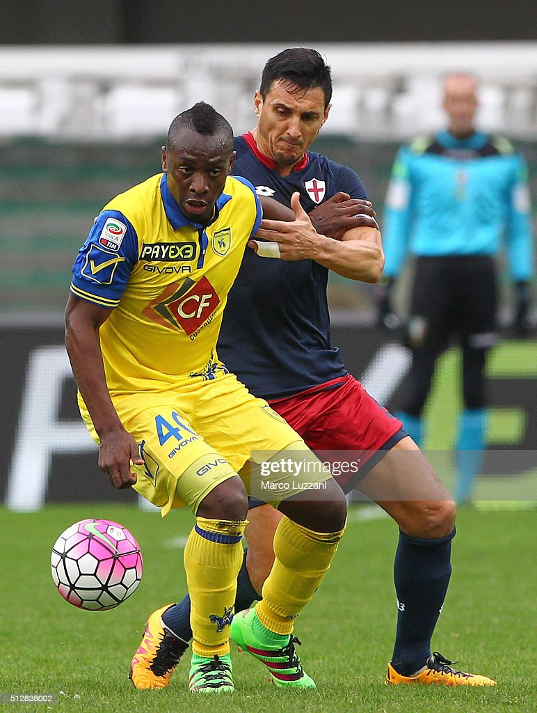 Paul Jose Mpoku of AC Chievo Verona competes for the ball with Nicolas Andres Burdisso of Genoa CFC during the Serie A match between AC Chievo Verona...