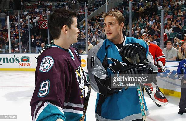 Paul Kariya of the Anaheim Ducks talks to Teemu Selanne of the San Jose Sharks during the NHL AllStar SuperSkills competition at the Office Depot...