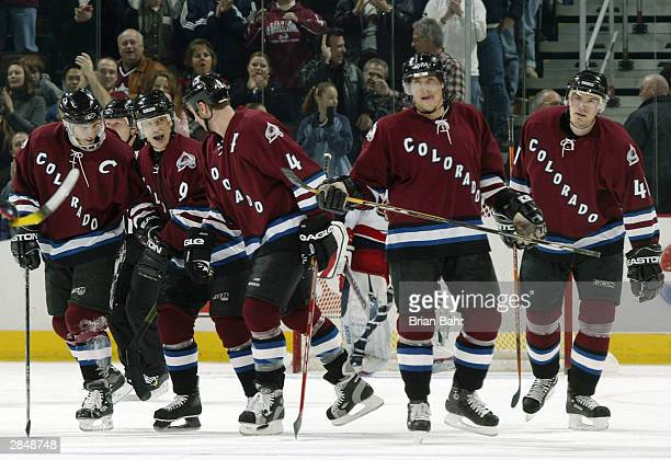 Paul Kariya of the Colorado Avalanche celebrates with Joe Sakic Rob Blake Teemu Selanne and Martin Skoula after scoring against the Columbus Blue...