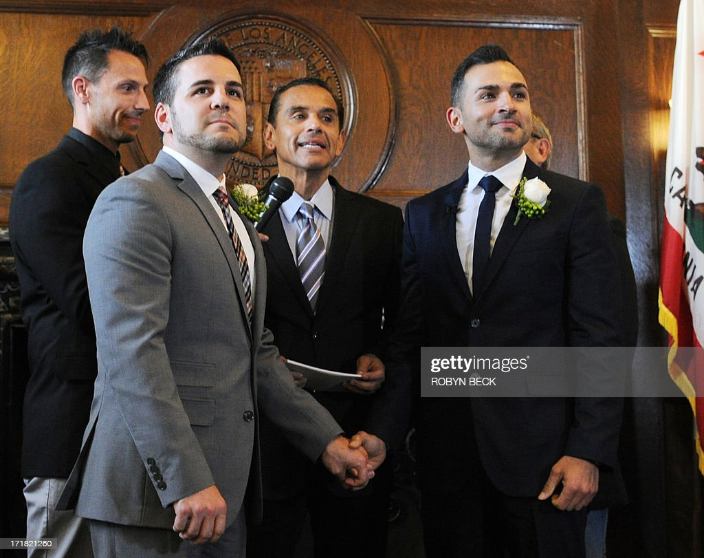 Paul Katami (L) and(R) are married by Los Angeles Mayor Antonio Villaraigosa (C) at Los Angeles City Hall June 28, 2013. Katami, Zarrillo and the other two plaintiffs in the U.S. Supreme Court case that overturned California's same-sex marriage ban were married June 28, after a federal appeals court freed gay couples to obtain marriage licenses in the state for the first time in 4 1/2 years.