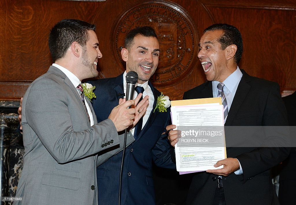 Paul Katami (L) and(R) are married by Los Angeles Mayor Antonio Villaraigosa at Los Angeles City Hall June 28, 2013. Katami, Zarrillo and the other two plaintiffs in the U.S. Supreme Court case that overturned California's same-sex marriage ban were married June 28, after a federal appeals court freed gay couples to obtain marriage licenses in the state for the first time in 4 1/2 years.