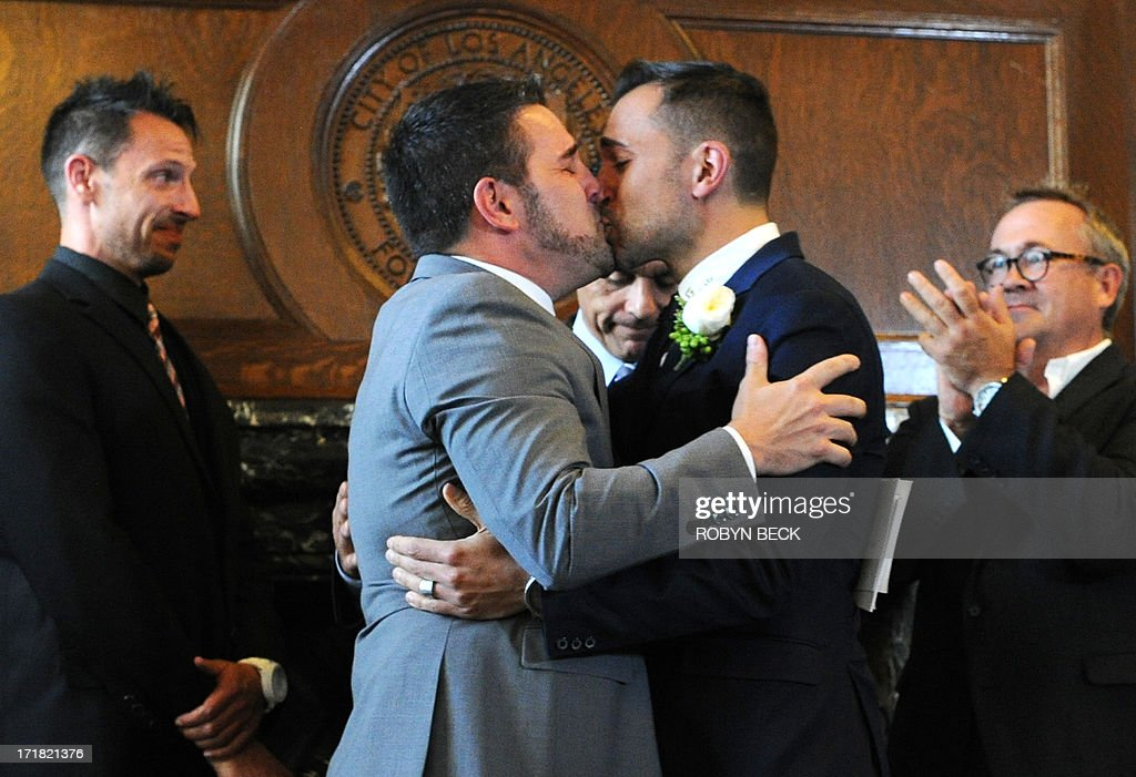 Paul Katami (L) and Jeff Karrillo (R) kissed after they are married by Los Angeles Mayor Antonio Villaraigosa at Los Angeles City Hall June 28, 2013. Katami, Zarrillo and the other two plaintiffs in the U.S. Supreme Court case that overturned California's same-sex marriage ban were married June 28, after a federal appeals court freed gay couples to obtain marriage licenses in the state for the first time in 4 1/2 years. AFP PHOTO / ROBYN BECK
