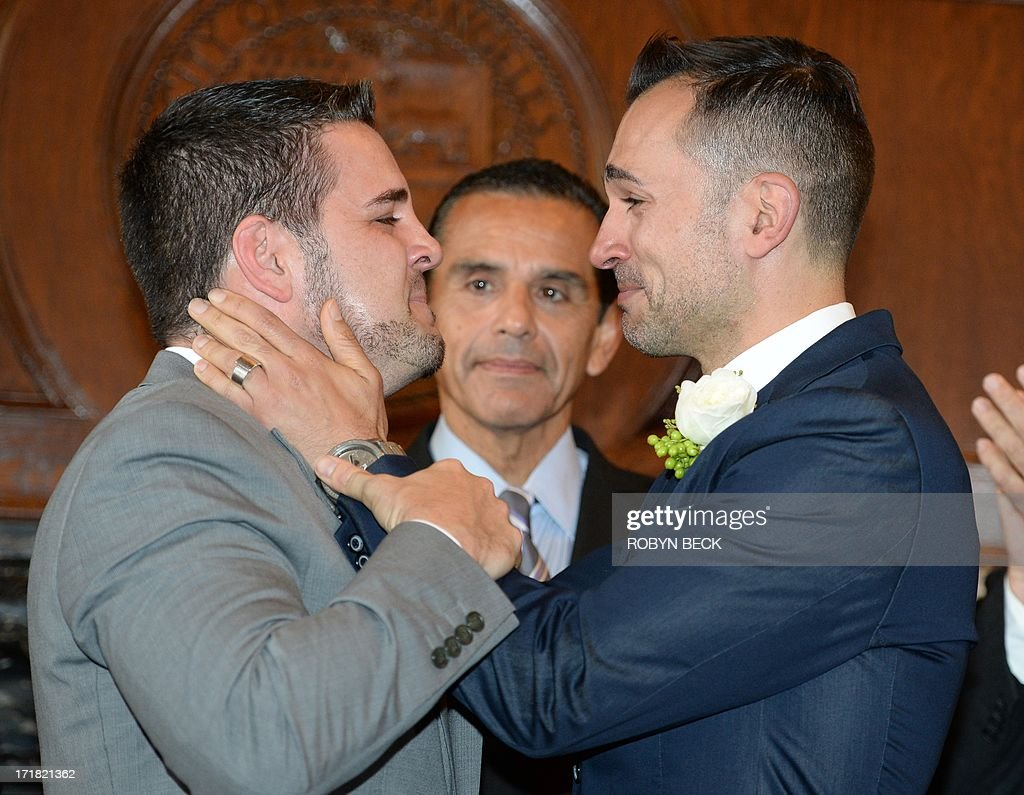 Paul Katami (L) and(R) react after they are married by Los Angeles Mayor Antonio Villaraigosa (C) at Los Angeles City Hall June 28, 2013. Katami, Zarrillo and the other two plaintiffs in the U.S. Supreme Court case that overturned California's same-sex marriage ban were married June 28, after a federal appeals court freed gay couples to obtain marriage licenses in the state for the first time in 4 1/2 years.