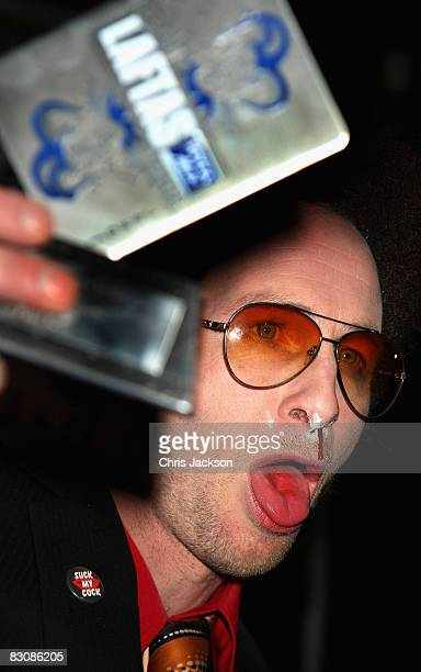 Paul Kaye is seen with fake cocaine on his nose as he holds up his award for 'Funniest TV Personality' during the LAFTAS at the Cuckoo Club on...