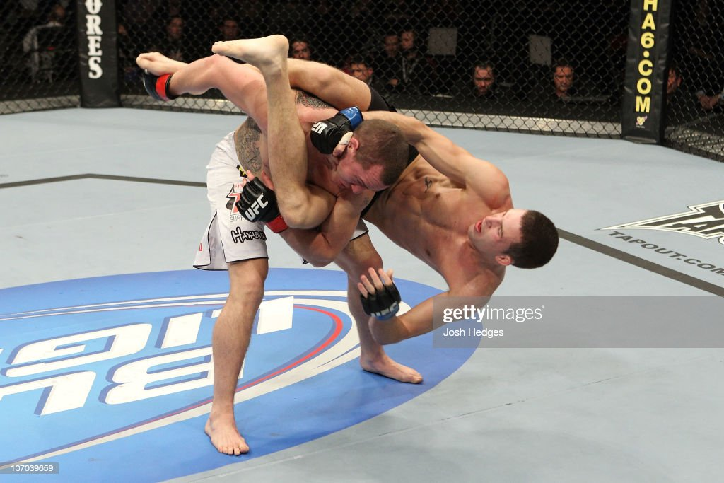 Paul Kelly fights against TJ O'Brien during their Lightweight bout part of UFC 123 at the Palace of Auburn Hills on November 20 2010 in Auburn Hills...