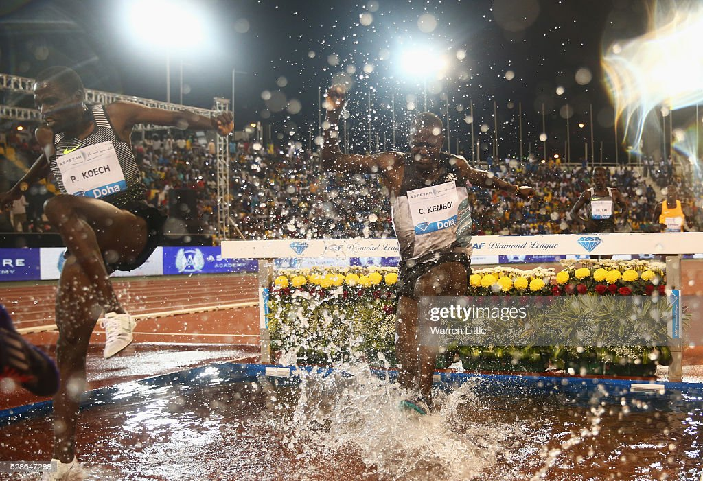 Paul Kipsiele Koech of Kenya and Clement Kimutai Kemboi of Kenya clear the water jump in the Men's 3000 metres Steeplechase final during the Doha IAAF Diamond League 2016 meeting at Qatar Sports Club on May 6, 2016 in Doha, Qatar.