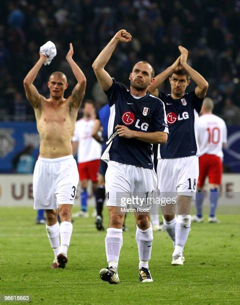 Paul Konchesky Danny Murphy and Aaron Hughes of Fulham wave to their fans after the UEFA Europa League semi final first leg match between Hamburger...
