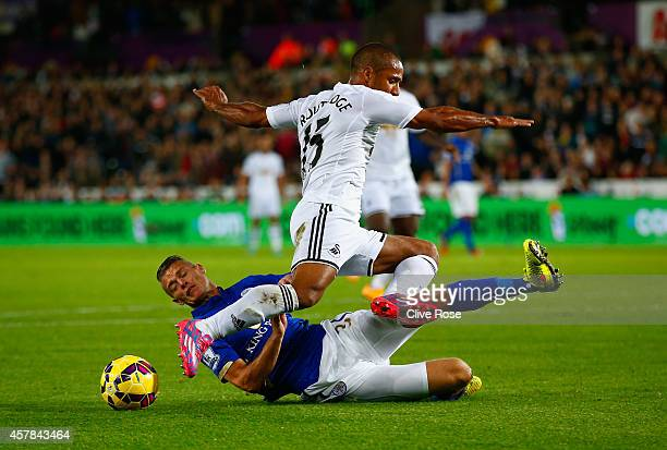 Paul Konchesky of Leicester City tackles Wayne Routledge of Swansea City during the Barclays Premier League match between Swansea City and Leicester...