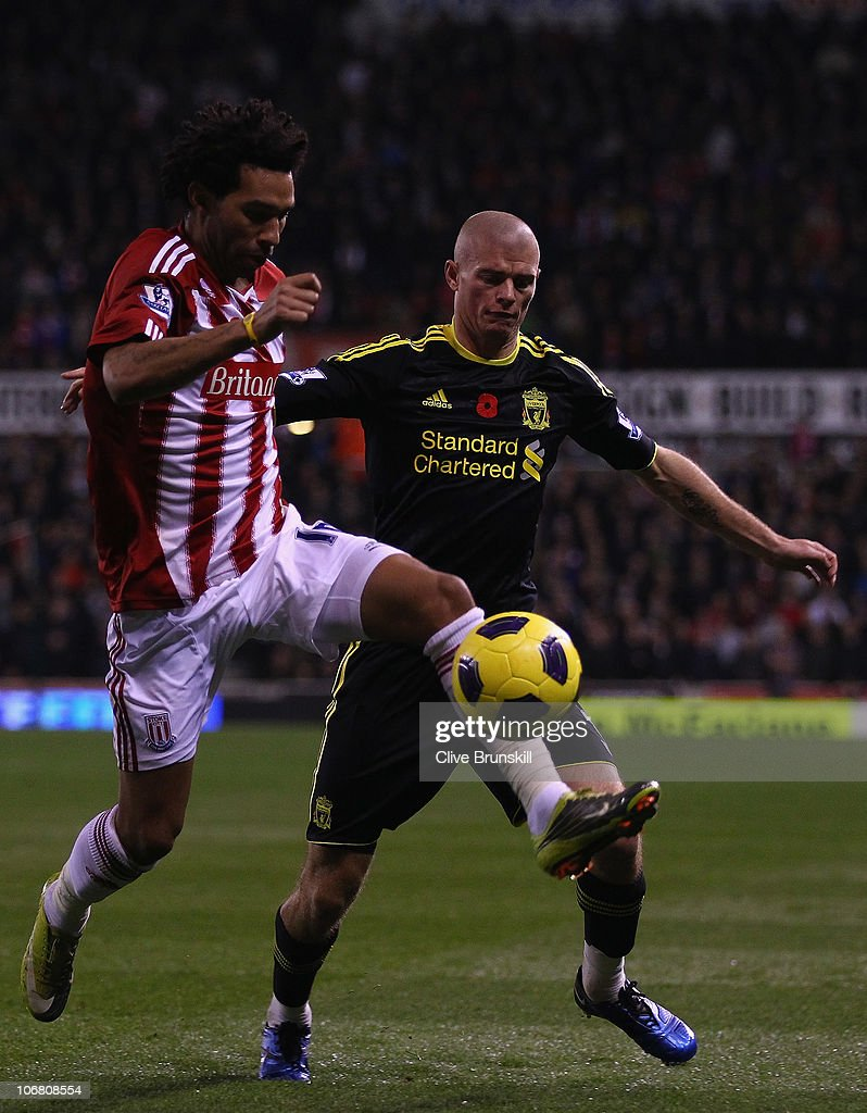 Paul Konchesky of Liverpool in action with Jermaine Pennant of Stoke City during the Barclays Premier League match between Stoke City and Liverpool at Britannia Stadium on November 13, 2010 in Stoke on Trent, England.