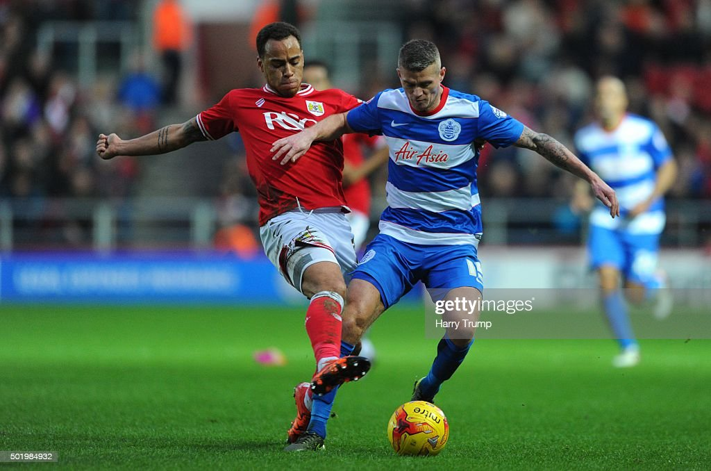 Paul Konchesky of Queens Park Rangers is tackled by Elliot Bennett of Bristol City during the Sky Bet Championship match between Bristol City and Queens Park Rangers at Ashton Gate on December 19, 2015 in Bristol, England.