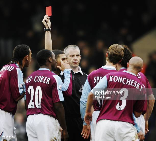 Paul Konchesky of West Ham United is shown the red card by referee Chris Foy during the Barclays Premiership match between Fulham and West Ham United...