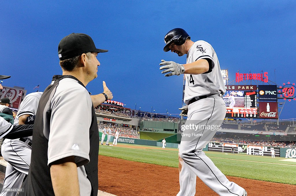 Paul Konerko #14 of the Chicago White Sox celebrates with manager Robin Ventura #23 after scoring in the second inning against the Washington Nationals at Nationals Park on April 11, 2013 in Washington, DC.
