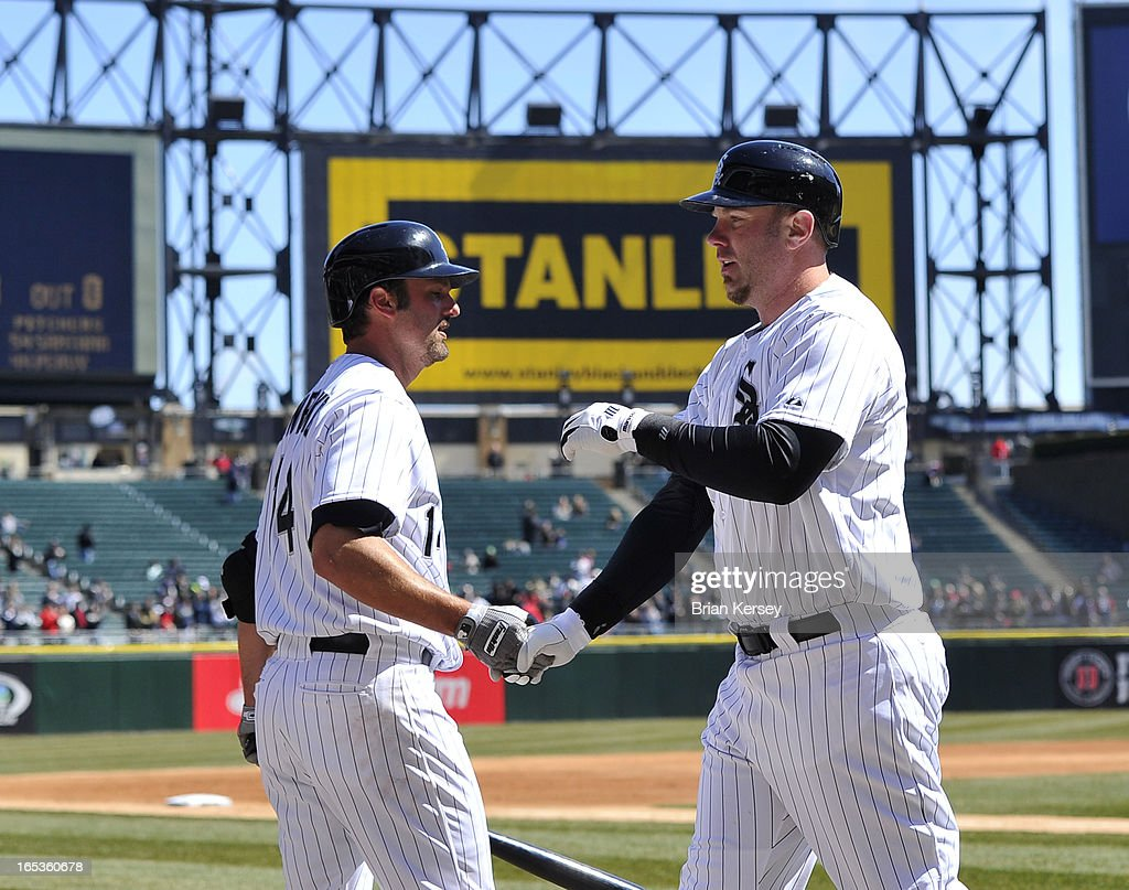 <a gi-track='captionPersonalityLinkClicked' href=/galleries/search?phrase=Paul+Konerko&family=editorial&specificpeople=203327 ng-click='$event.stopPropagation()'>Paul Konerko</a> #14 of the Chicago White Sox (L) congratulates teammate <a gi-track='captionPersonalityLinkClicked' href=/galleries/search?phrase=Adam+Dunn&family=editorial&specificpeople=213505 ng-click='$event.stopPropagation()'>Adam Dunn</a> #32 after Dunn's solo home run during the second inning against the Kansas City Royals on April 3, 2012 at U.S. Cellular Field in Chicago, Illinois.