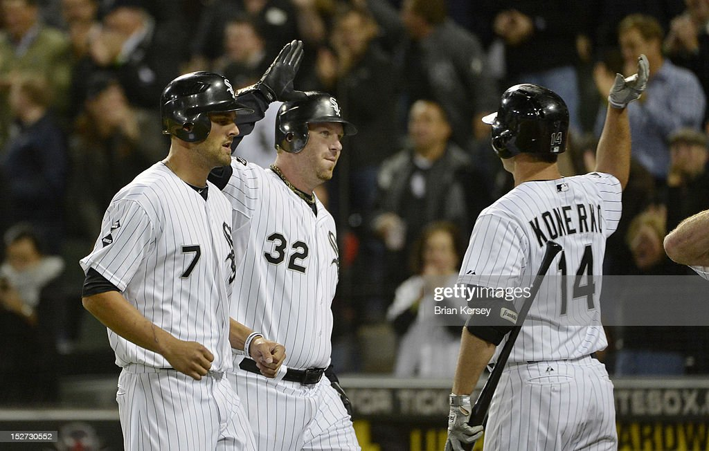 <a gi-track='captionPersonalityLinkClicked' href=/galleries/search?phrase=Paul+Konerko&family=editorial&specificpeople=203327 ng-click='$event.stopPropagation()'>Paul Konerko</a> #14 of the Chicago White Sox (R) high-fives <a gi-track='captionPersonalityLinkClicked' href=/galleries/search?phrase=Adam+Dunn&family=editorial&specificpeople=213505 ng-click='$event.stopPropagation()'>Adam Dunn</a> #32 after Dunn hit a three-run home run scoring Jordan Danks #7 and Kevin Youkilis #20 during the eighth inning against the Cleveland Indians at U.S. Cellular Field on September 24, 2012 in Chicago, Illinois. The White Sox defeated the Indians 5-4.