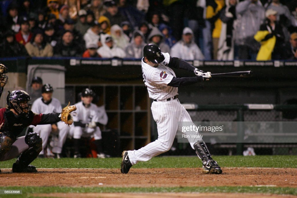 Paul Konerko #14 of the Chicago White Sox hits a grand slam home run off of Chad Qualls in the seventh inning during Game 2 of the 2005 World Series against the Houston Astros at US Cellular Field on October 23, 2005 in Chicago, Illinois. The White Sox defeated the Astros 7-6.