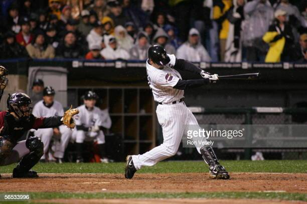 Paul Konerko of the Chicago White Sox hits a grand slam home run off of Chad Qualls in the seventh inning during Game 2 of the 2005 World Series...