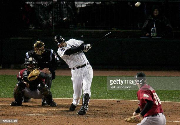 Paul Konerko of the Chicago White Sox hits a grandslam home run against pitcher Chad Qualls of the Houston Astros in the seventh inning during Game...