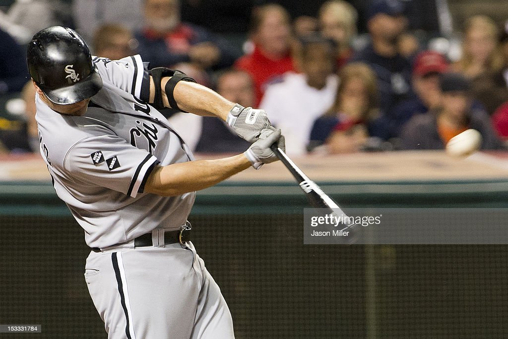 Paul Konerko #14 of the Chicago White Sox hits a solo home run during the fifth inning against the Cleveland Indians at Progressive Field on October 3, 2012 in Cleveland, Ohio.