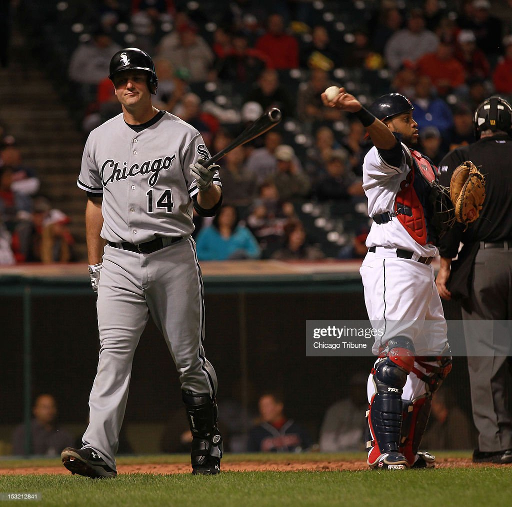 Paul Konerko of the Chicago White Sox out on a drop 3rd strike in the 4th inning against the Cleveland Indians at Progressive Field in Cleveland, Ohio on Monday, October 1, 2012.