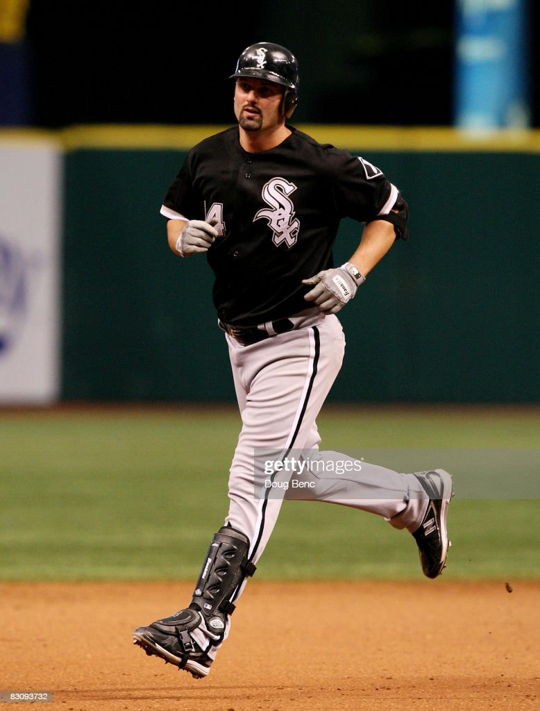 Paul Konerko #14 of the Chicago White Sox rounds the bases after hitting a solo home run in the ninth inning against the Tampa Bay Rays in Game 1 of the American Leaugue Divisional Series at Tropicana Field on October 2, 2008 in St. Petersburg, Florida. The Rays defeated the White Sox 6-4.