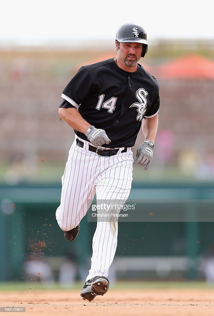 <a gi-track='captionPersonalityLinkClicked' href=/galleries/search?phrase=Paul+Konerko&family=editorial&specificpeople=203327 ng-click='$event.stopPropagation()'>Paul Konerko</a> #14 of the Chicago White Sox runs to third base during the spring training game against Team USA at Camelback Ranch on March 5, 2013 in Glendale, Arizona.