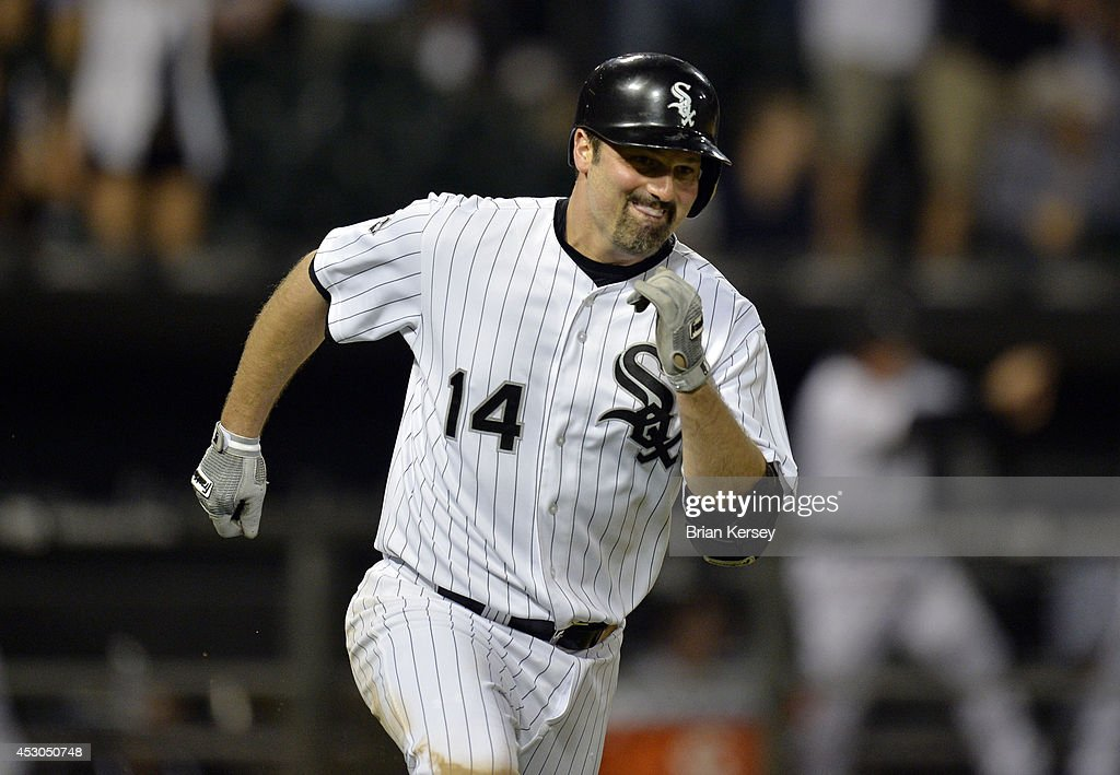 <a gi-track='captionPersonalityLinkClicked' href=/galleries/search?phrase=Paul+Konerko&family=editorial&specificpeople=203327 ng-click='$event.stopPropagation()'>Paul Konerko</a> #14 of the Chicago White Sox runs up the first base line after hitting an RBI single scoring teammate Adam Eaton during the eighth inning against the Minnesota Twins at U.S. Cellular Field on August 1, 2014 in Chicago, Illinois.