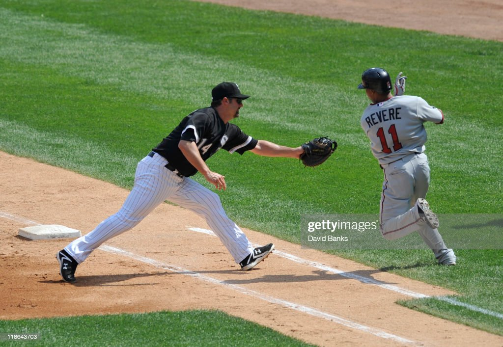 <a gi-track='captionPersonalityLinkClicked' href=/galleries/search?phrase=Paul+Konerko&family=editorial&specificpeople=203327 ng-click='$event.stopPropagation()'>Paul Konerko</a> #14 of the Chicago White Sox tags Ben Revere #11 of the Minnesota Twins out at first base on July 9, 2011 at U.S. Cellular Field in Chicago, Illinois. The White Sox defeated the Twins 4-3.