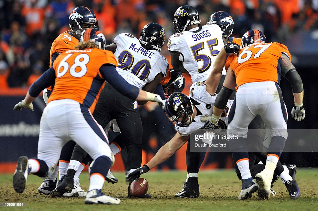 Paul Kruger #99 of the Baltimore Ravens reachs for a fumble by the offense against Zane Beadles #68 and Dan Koppen #67 of the Denver Broncos during the AFC Divisional Playoff Game at Sports Authority Field at Mile High on January 12, 2013 in Denver, Colorado.