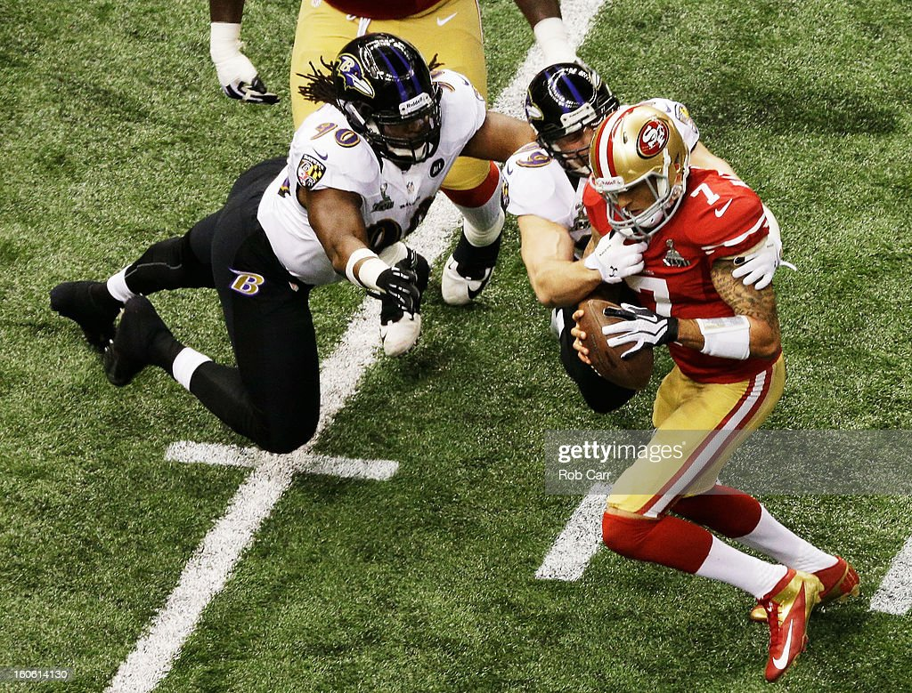 Paul Kruger #99 of the Baltimore Ravens sacks Colin Kaepernick #7 of the San Francisco 49ers in the first quarter during Super Bowl XLVII at the Mercedes-Benz Superdome on February 3, 2013 in New Orleans, Louisiana.