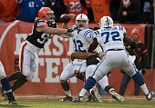 Paul Kruger of the Cleveland Browns hits Andrew Luck of the Indianapolis Colts and forces a fumble which is recovered for a touchdown during the...