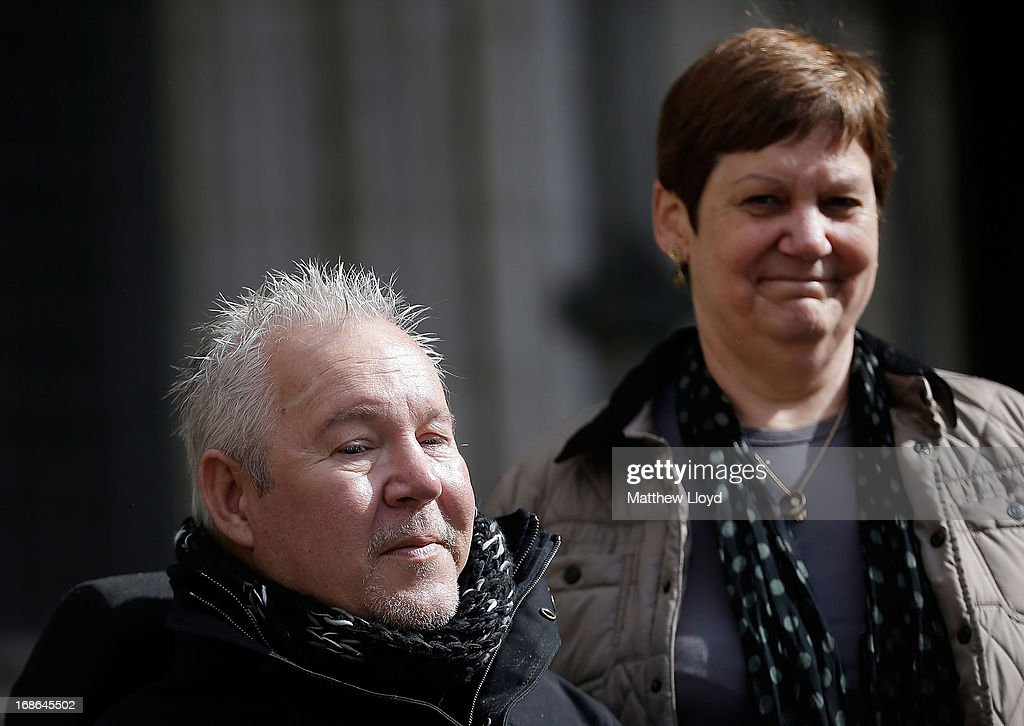 Paul Lamb and Jane Nicklinson arrive at the Royal Courts of Justice for the first day in a three day hearing on legalising the right to die with the aid of a doctor on May 13, 2013 in London, England. Mr Lamb, who is paralysed from the neck down, is continuing the legal battle started by the late Tony Nicklinson, who suffered from locked in syndrome.