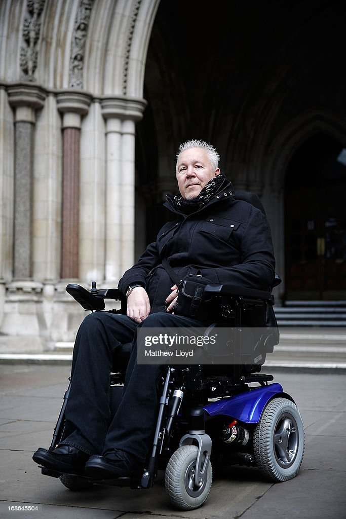 Paul Lamb, 58, poses for a photograph outside the Royal Courts of Justice on the first day in a three day hearing on legalising the right to die with the aid of a doctor on May 13, 2013 in London, England. Mr Lamb, who is paralysed from the neck down, is continuing the legal battle started by the late Tony Nicklinson, who suffered from locked in syndrome.