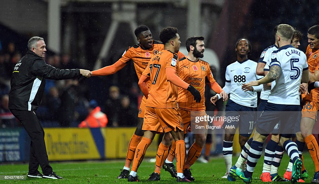 Paul Lambert manager / head coach of Wolverhampton Wanderers holds back Dominic Iorfa of Wolverhampton Wanderers during the Sky Bet Championship match between Preston North End and Wolverhampton Wanderers at Deepdale on November 19, 2016 in Preston, England.