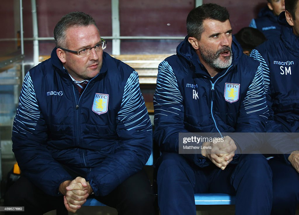 Paul Lambert manager of Aston Villa and assistant Roy Keane look on from the bench prior to the Barclays Premier League match between Aston Villa and...