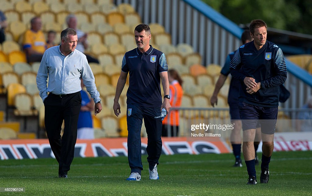 Paul Lambert manager of Aston Villa and <a gi-track='captionPersonalityLinkClicked' href=/galleries/search?phrase=Roy+Keane&family=editorial&specificpeople=171835 ng-click='$event.stopPropagation()'>Roy Keane</a> assistant manager before the pre season friendly match between Mansfield Town and Aston Villa at the One Call Stadium on July 17, 2014 in Mansfield, England.