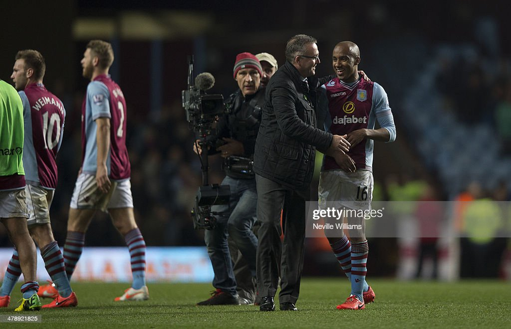 Paul Lambert manager of Aston Villa congratulates <a gi-track='captionPersonalityLinkClicked' href=/galleries/search?phrase=Fabian+Delph&family=editorial&specificpeople=5443479 ng-click='$event.stopPropagation()'>Fabian Delph</a> of Aston Villa after the Barclays Premier League match between Aston Villa and Chelsea at Villa Park on March 15, 2014 in Birmingham, England.