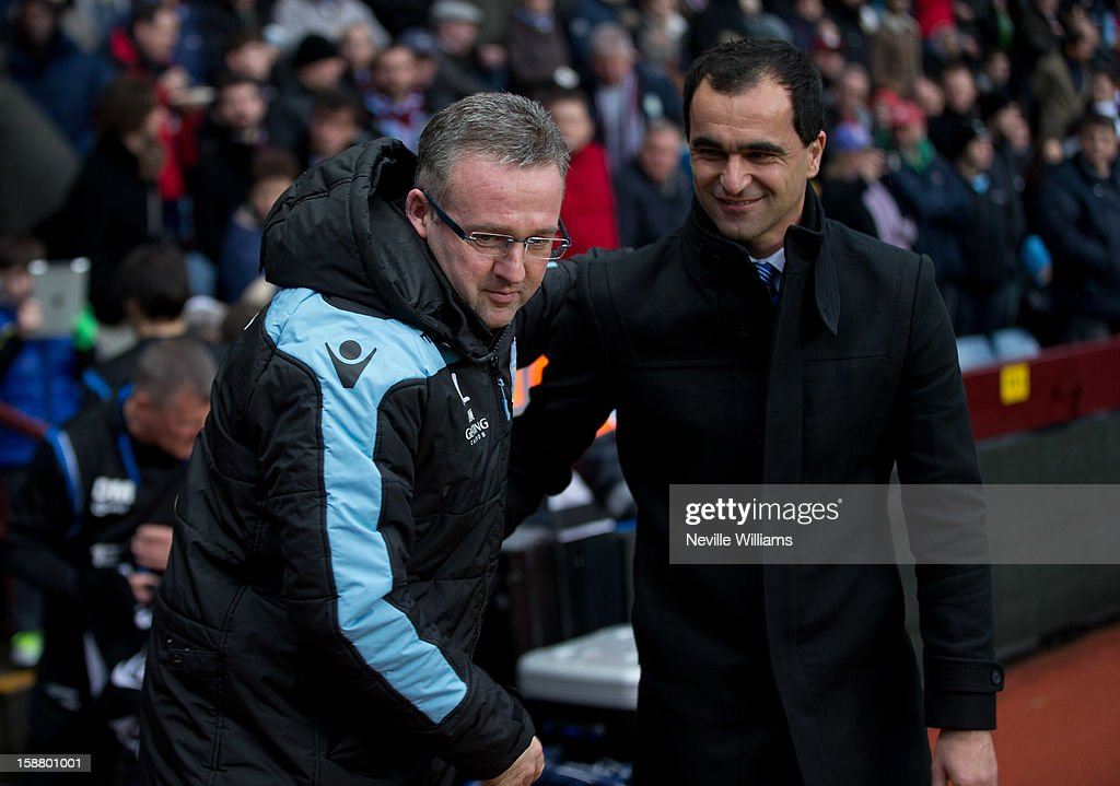 Paul Lambert, manager of Aston Villa greets Roberto Martinez, manager of Wigan Athletic before the Barclays Premier League match between Aston Villa and Wigan Athletic at Villa Park on December 29, 2012 in Birmingham, England.