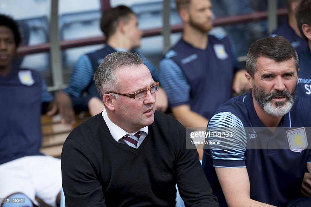 Paul Lambert manager of Aston Villa next to Roy Keane, looks on during the Barclays Premier League match between Aston Villa and Hull City at Villa Park on August 31, 2014 in Birmingham, England.